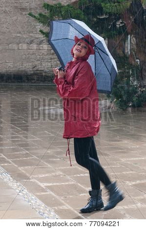 Young Woman Walking In The Rain