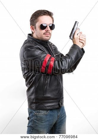 Man In Black Leather Jacket And Sunglasses With Gun
