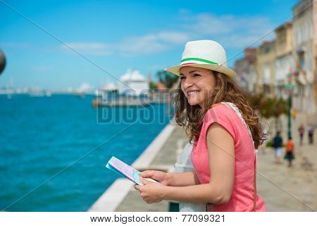 Happy Woman With Map In Venice