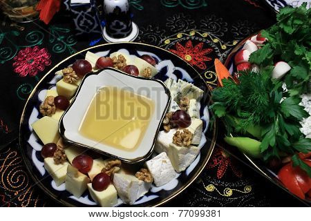 Plate With Honey And Cheese Slices