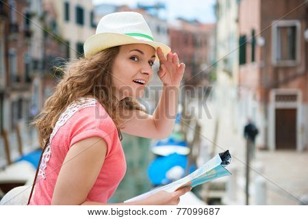 Young Woman With Map In Venice