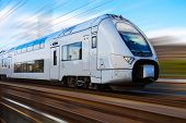 stock photo of passenger train  - Modern high speed train with motion blur effect in Stockholm - JPG