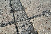 stock photo of pavestone  - Grey concrete pavement surface with various texture - JPG