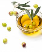 foto of fruit bowl  - twig of olives with fruits in a bowl with olive oil isolated on white - JPG