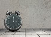 pic of count down  - Alarm clock counting down to twelve against grey room - JPG