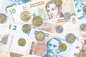 stock photo of pesos  - Money from Argentina peso banknotes and coins - JPG