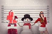stock photo of mug shot  - Santa covers his face with presents against mug shot background - JPG