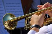 stock photo of trumpets  - Close up view of musician playing trumpet in street orchestra