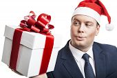 stock photo of boxing day  - man holding a gift box on a white background - JPG