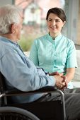 stock photo of visitation  - Nurse visiting disabled patient in his home - JPG