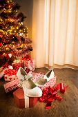 foto of shoe-box  - White female elegant shoes in a gift box with christmas tree and presents on background - JPG