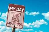 foto of humility  - My Day Begins and Ends With Gratitude sign with sky background - JPG