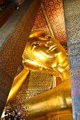 stock photo of recliner  - Reclining Buddha gold statue Wat Pho Bangkok Thailand - JPG