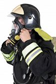 stock photo of fire-breathing  - Firefighter corrects overview mask breathing apparatus - JPG