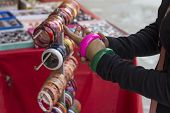 stock photo of bangles  - multicolor bangles arranged and displayed in the waiting customers - JPG