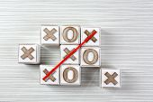 pic of tic-tac-toe  - Game of Tic Tac Toe on wooden background - JPG