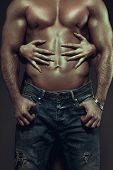 stock photo of hot couple  - Hot couple at night woman hands embracing sexy man abs vintage style - JPG