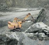 picture of asbestos  - Excavator breed produces asbestos in a quarry - JPG