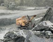 stock photo of asbestos  - Mineral asbestos on the background of the excavator in a quarry - JPG