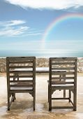 picture of beachfront  - old wooden chairs and table at beachfront - JPG