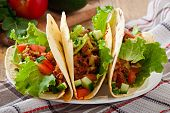 stock photo of shredded cheese  - Mexican tacos with meat - JPG