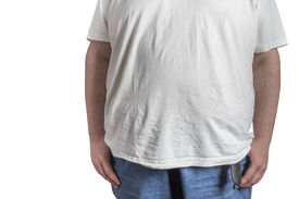 image of bulging belly  - overweight Man in blue jeans and white t - JPG