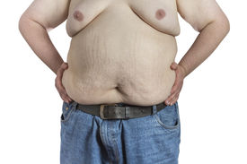 stock photo of bulging belly  - Shirtless overweight Man in blue jeans with hands on his hips isolated on white background - JPG
