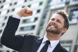 stock photo of shout  - A young successful man - JPG