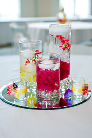 foto of wedding table decor  - wedding centerpiece with floating candles and flowers  - JPG