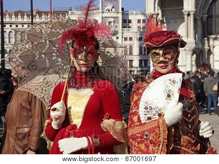 Masked Women In Red Costume On San Marco Square, Venice