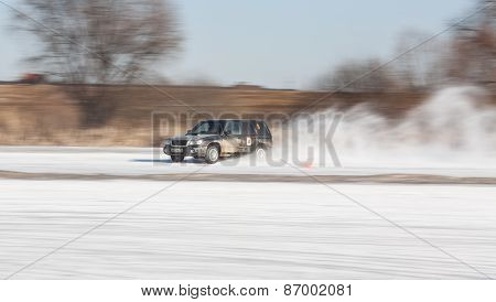 Black subaru Forester on ice track