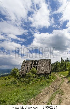 Wooden hut on mountain path