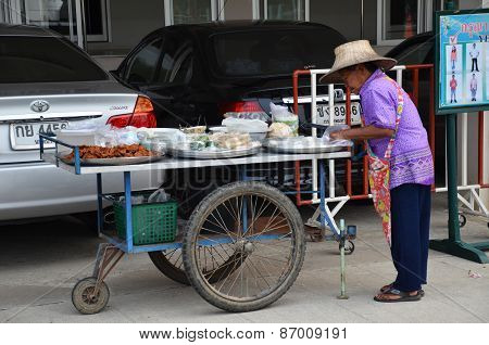 An Unidentified Street Vendor Prepares Food At Street In Bangkok, Thailand