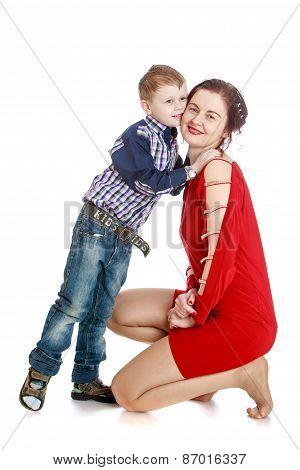Little boy kissing his beloved mother.