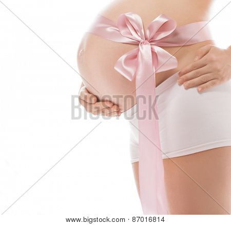 pregnant caucasian woman closeup body isolated on white background studio shot belly pink side view