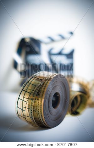 35Mm Movie Reel With Out Of Focus Clapper In Background, Vertical