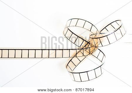 35Mm Movie Filmstrip, Film Bow On White Background