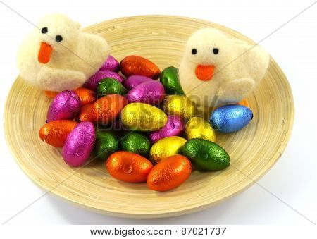 Ducklings and colorful eggs of chocolate