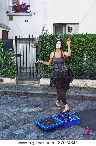 Mime Dancing With A Magic Ball On The Head In Montmartre, Paris, France.