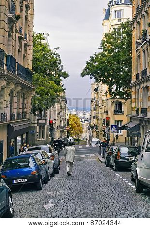 People Walk On The Montmartre District In Paris, France.