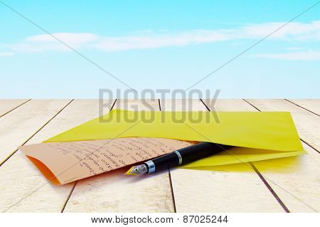 Envelope With A Letter On The Table