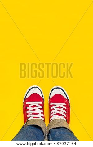 Feet From Above, Teenager In Sneakers Standing On Yellow Background
