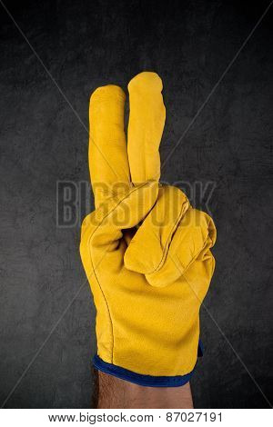 Hand In Leather Construction Work Gloves Making Two Fingers Gesture
