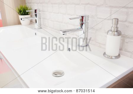Closeup of a wash basin in a modern bathroom