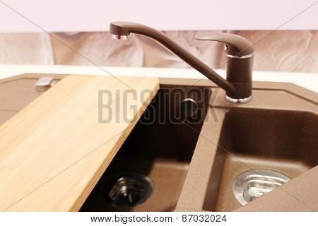 New brown kitchen sink with faucet