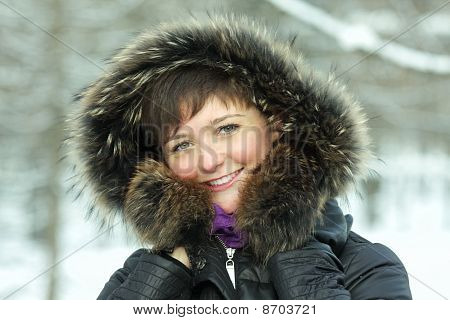 Smiling Woman In Frosty Day Hands At Hood