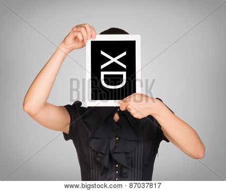 Woman in dress covered her face with tablet. On screen code smiley