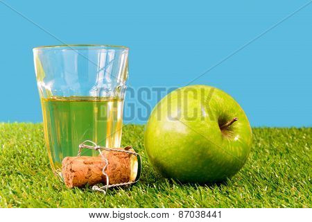 A Green Apple With A Glass Of Cider