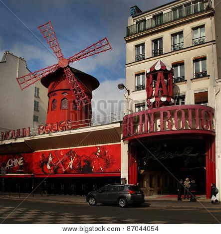 PARIS-MARCH 03, 2015: Moulin Rouge is a cabaret in Paris, France it is marked by the red windmill on its roof and best known as the spiritual birthplace of the modern form of the can-can dance.