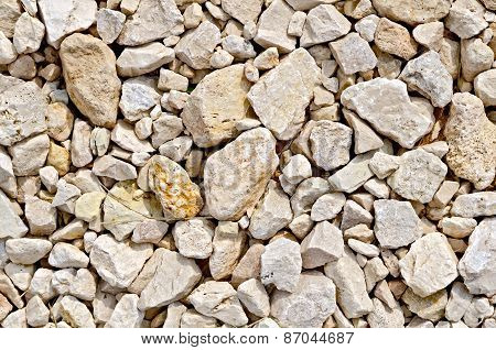 Crushed sandstone on road